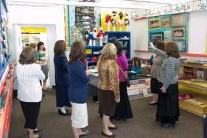Women principals in classroom tour
